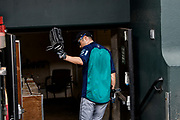 """Baltimore, Maryland - June 25, 2018: Seattle Mariners star Ichiro Suzuki fades into the visiting team locker room at Camden Yards in Baltimore before the Mariners play the Orioles Monday June 25, 2018. <br /> <br /> He goes through all the pre-game warm ups like any position player on the Seattle Mariners, before their game against the Baltimore Orioles at Camden Yard Monday June 25th  -- except his current position is """"Special Assistant to the Chairman,"""" in the ball club's front office.<br /> He does everything an active player does except play. His new position in management forbids him from being in the dugout during game play, so he soaks up as much time with the players before the first pitch. <br /> <br /> CREDIT: Matt Roth for The New York Times<br /> Assignment ID: 30221475A"""