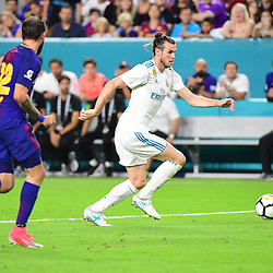 (R-L)  Gareth Bale of Real Madrid and Aleix Vidal of Barcelona during the International Champions Cup match between Barcelona and Real Madrid at Hard Rock Stadium on July 29, 2017 in Miami Gardens, Florida. (Photo by Dave Winter/Icon Sport)
