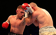 Paul Hyland Jr (left) in action against Stephen Ormond during their IBF East/West Europe Lightweight Championship bout at the SSE Arena, Belfast.