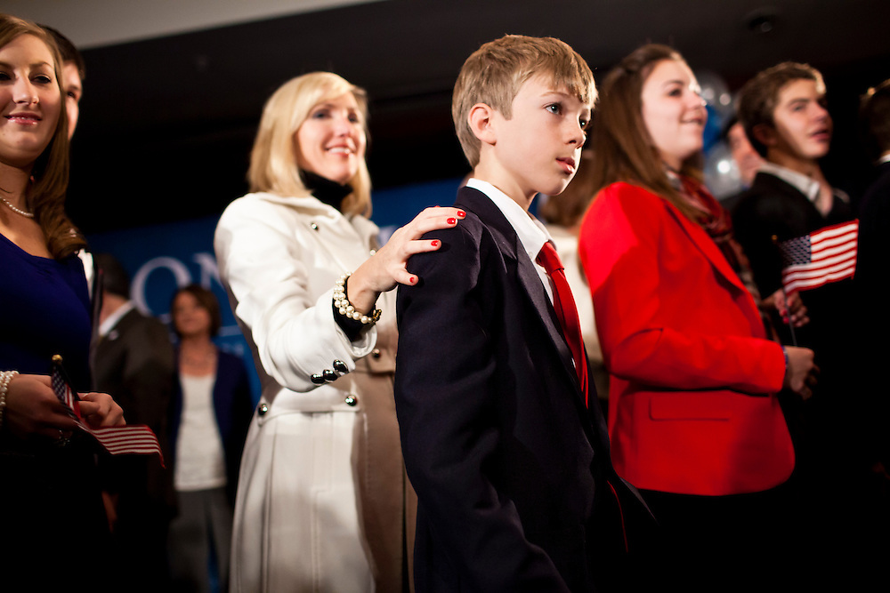 Family and friends of Republican presidential candidate Ron Paul leave the stage at the end of a caucus night rally on Tuesday, January 3, 2012 in Ankeny, IA.