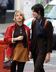 Peaches Geldof and boyfriend Thomas Cohen from S.C.U.M share a passionate kiss as they take a stroll in north London. Peaches supporting a love bite on her neck and purple nail polish also on Thomas's nails. 05/04/2011<br />