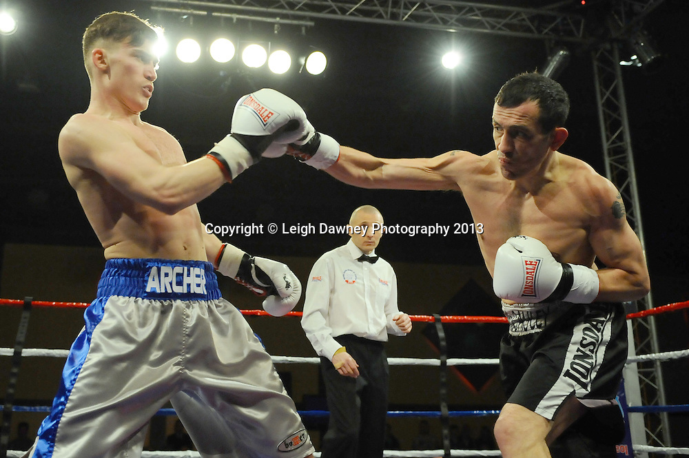 Paul Archer (silver/blue shorts) defeats Kevin McCauley in a 6x3 Welterweight contest at Rainton Meadows Arena, Houghton Le Spring, Tyne & Wear, UK. 15th February 2013. Frank Maloney Promotions. © Leigh Dawney 2013