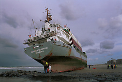 "The German cargo ship ""Heinrich Behrmann"", was run-aground by heavy seas, after losing power to her main engine, on the beach in Blankenberge, Belgium. The ship was heading for the port at Zeebrugge from Ireland, and was carrying dry cargo, none of which was hazardous. The salvage company Unie Van Redding - En Sleepdienst N.V. was hired to free the ship. Three unsuccessful attempts were made, the second attempt resulted in the injury of two workers when tug boat cables snapped. (Photo © Jock Fistick)"