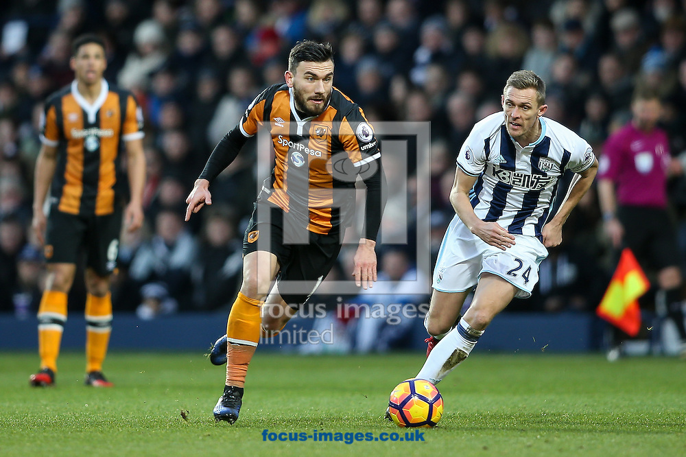 Robert Snodgrass of Hull City (centre) ahead of Darren Fletcher of West Bromwich Albion (right) during the Premier League match at The Hawthorns, West Bromwich<br /> Picture by Andy Kearns/Focus Images Ltd 0781 864 4264<br /> 02/01/2017