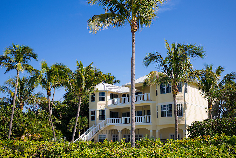 Luxury hotel surrounded by palm trees at upmarket South Seas Island Resort on Captiva Island in subtropical Florida, USA