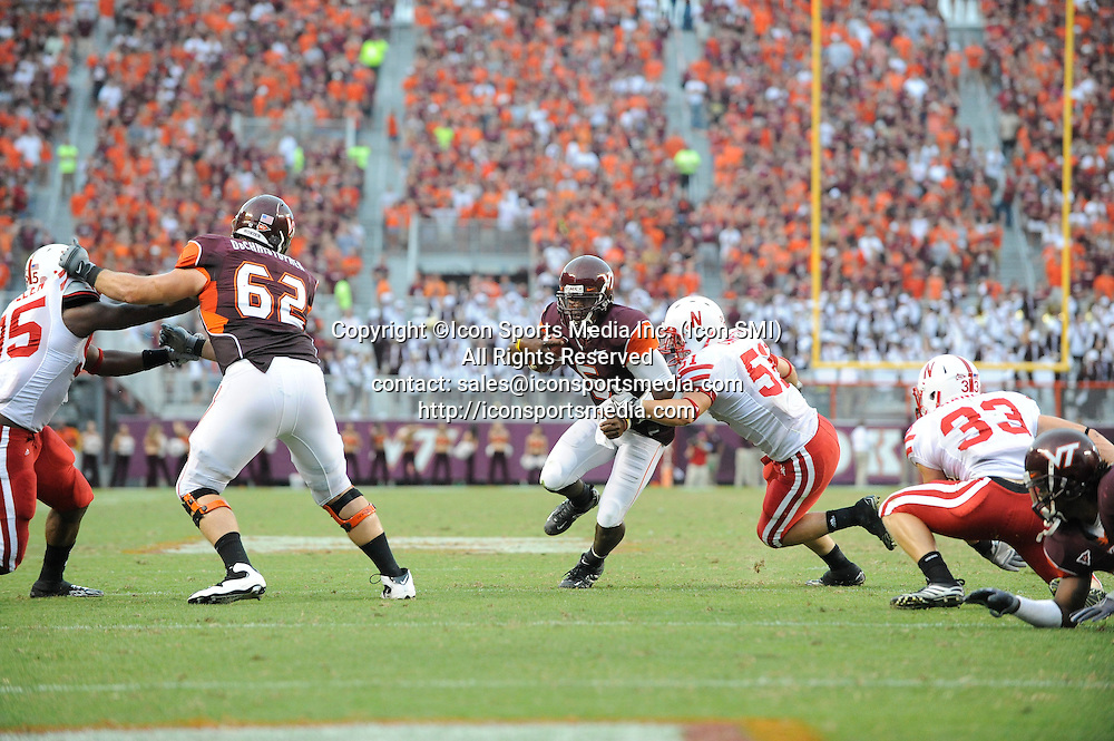 19 September 2009: Virginia Tech quarterback Tyrod Taylor (5) and Nebraska linebacker Will Compton (51) during the Hokies 16-15 win over the Nebraska Huskers at Worsham Field at Lane Stadium in Blacksburg, VA