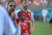 Arsenal defender Calum Chambers (21) with a young Arsenal fan during the introductions at their game against Fiorentina during an International Champions Cup game, Saturday, July 20, 2010, in Charlotte, NC. Arsenal defeated Fiorentina 3-0. (Brian Villanueva/Image of Sport)