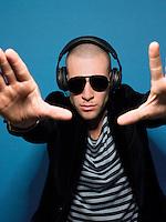 Man wearing headphones in studio view through hands
