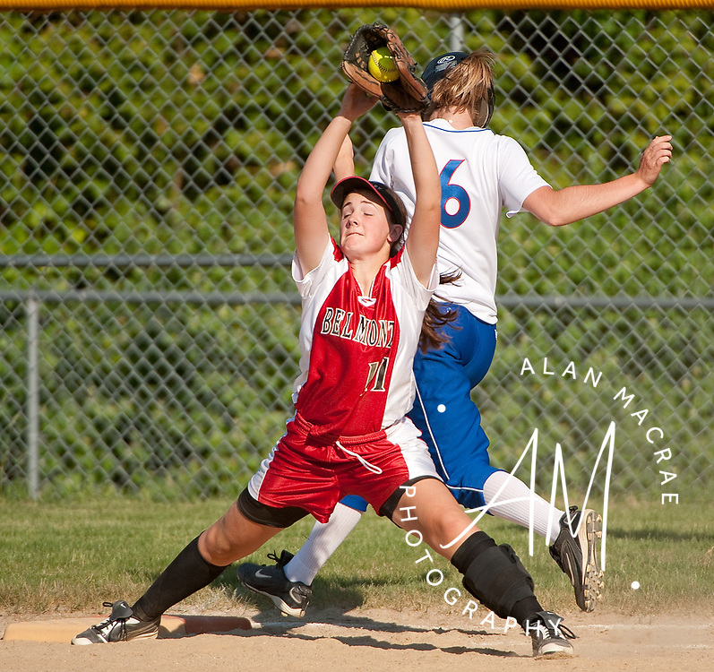 Belmont's C. Clary [11] cinches a catch at first base, getting the out on Inter Lakes Nicole Moodie during Wednesday's game at Belmont.  (Alan MacRae/for the Citizen)