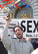 Michael Marcavage of Repent America holds up a bible during a protest against same-sex marriage outside of San Francisco City Hall on Feb. 20...Photo by Jason Doiy.02-20-2004