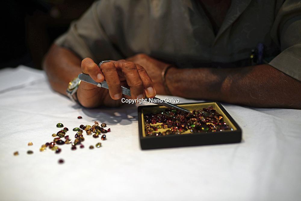 Jeweler shows gems in jewellery shop, Galle, Sri Lanka