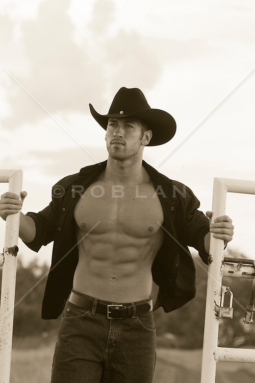 sexy cowboy opening up a gate
