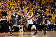 June 3, 2018; Oakland, CA, USA; Golden State Warriors guard Stephen Curry (30) celebrates with forward Draymond Green (23) during the fourth quarter against the Cleveland Cavaliers in game two of the 2018 NBA Finals at Oracle Arena.