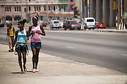 Teenage girls walk along the malecon in Havana, Cuba on Saturday June 28, 2008.