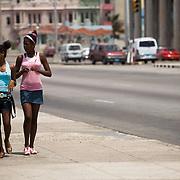 Teenage girls walk along the malecon in Havana, Cuba on Saturday June 28, 2008.