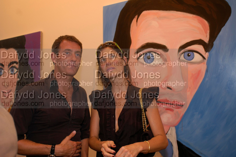 Tim Jefferies and Elizabeth Saltzman  in front of Stella Vine's painting of Tim. 'Stellawood' exhibition of work by Stella Vine, Hamiltons. Carlos Place. London. 22 June 2005. ONE TIME USE ONLY - DO NOT ARCHIVE  © Copyright Photograph by Dafydd Jones 66 Stockwell Park Rd. London SW9 0DA Tel 020 7733 0108 www.dafjones.com