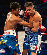 Manny Pacquiao of the Philippines (L) fights Chris Algieri of United States during their World Welterweight Championship bout at the Cotai Arena on November 23, 2014 in Macau, China. AFP PHOTO / XAUME OLLEROS