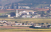 A North Korean village in Kaepung county, North Hwanghae province, North Korea is seen in this picture taken from Ganghwa Peace Observatory of South Korea, about 2 km (1.2 miles) south of North Korean territory, in Ganghwa, 56 km (35 miles) northwest of Seoul, South Korea, October 2, 2017. Photo by Lee Jae-Won (KOREA) www.leejaewonpix.com