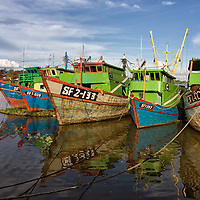 Colourful painted fishing boats in Kuching.