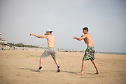 Young local boxers train on a beach by the Caspian Sea. Fighting is embedded in to the culture of Dagestan and it is renowned around the world for producing large numbers of great fighters from wrestlers to mixed martial arts. The Russian government in Moscow also sends large amounts of funding to help train such fighters. <br /> <br /> Located in the North Caucasus, bordering the Caspian Sea and a Republic of Russia, Dagestan is home to almost 3 million mostly muslim people. Ethnically very diverse, it is made up of several dozen ethnic groups and is Russia's most heterogeneous republic, where no ethnicity forms a majority.<br /> <br /> From 2000 until late 2012 Dagestan was subject to a violent Islamic separatist movement that spilled over from neighbouring Chechnya but has now been largely controlled by the Russian Government.<br /> <br /> Now relatively peaceful Dagestan (which means Land of Mountains) remains one of Russia's untouched treasures receiving few visitors. Due to its relative isolation, this beautiful mountainous region has maintained its traditional cultures that have been lost in many other parts of Russia.