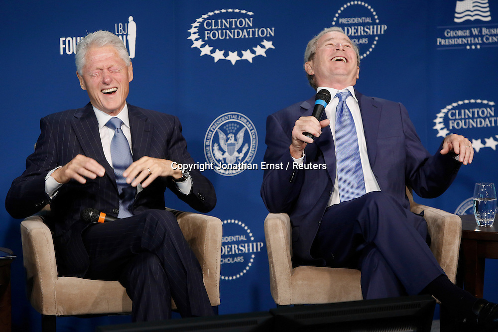 Former U.S. presidents Bill Clinton and George W. Bush laugh about life after the presidency as they participate in an onstage conversation at a Presidential Leadership Scholars event at the Newseum in Washington.