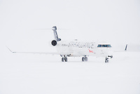 Air Canada Jazz CRJ-705 in snowstorm