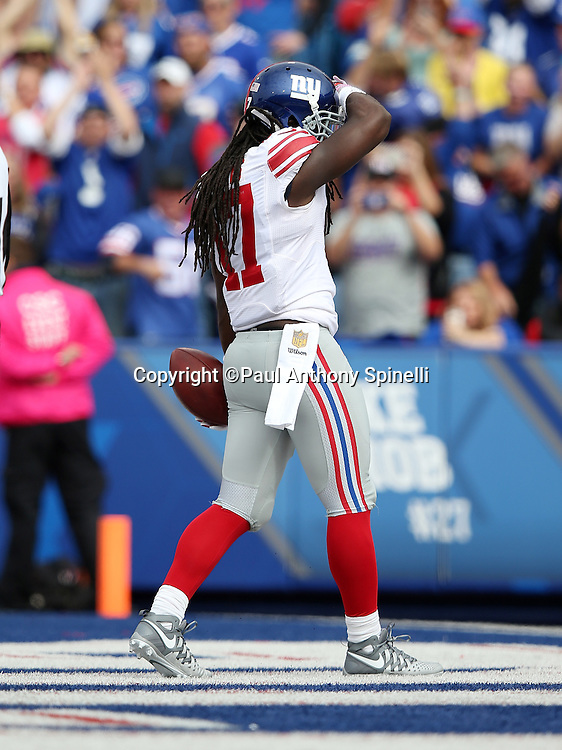 New York Giants wide receiver Dwayne Harris (17) celebrates after catching a 21 yard touchdown catch and run good for a 9-3 first quarter Giants lead during the 2015 NFL week 4 regular season football game against the Buffalo Bills on Sunday, Oct. 4, 2015 in Orchard Park, N.Y. The Giants won the game 24-10. (©Paul Anthony Spinelli)