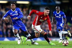 Marcos Rojo of Manchester United is challenged by Michy Batshuayi of Chelsea - Rogan Thomson/JMP - 13/03/2017 - FOOTBALL - Stamford Bridge - London, England - Chelsea v Manchester United - FA Cup Quarter Final..