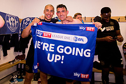 Free to use courtesy of Sky Bet - Gary Roberts and James Vaughan of Wigan Athletic celebrate winning promotion to the Sky Bet Championship - Mandatory by-line: Robbie Stephenson/JMP - 21/04/2018 - FOOTBALL - Highbury Stadium - Fleetwood, England - Fleetwood Town v Wigan Athletic - Sky Bet League One