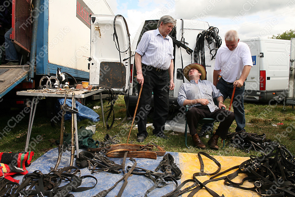 Sean Byrne, Pat Dobbin and Stephan Byrne with their tackle at the annual Spancilhill Horse Fair on Tuesday.<br /> Photograph by Yvonne Vaughan