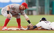 Jun 22, 2016; Houston, TX, USA; Los Angeles Angels second baseman Johnny Giavotella (12) tags out Houston Astros left fielder Tony Kemp (16) while trying to steal second base in the eighth inning at Minute Maid Park. Mandatory Credit: Thomas B. Shea-USA TODAY Sports
