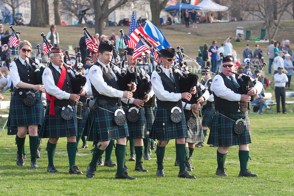 West Point, New York - Pipe and drum bands march off the field at the end of the 32nd annual West Point Military Tattoo at Trophy Point at the United States Military Academy on April 13, 2014.