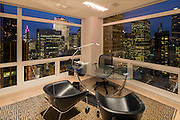 The interior of a modern apartment, #38FGH at Trump Tower, 741 Fifth Avenue in New York City, photographed at dusk.