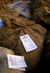 Stock photo of burlap sacks filled with freshly collected oysters