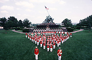 The Marine Band poses for their official photos at the Iwo Jima Memorial. J Walter Thompson advertising agency was the Ad agency for the Marine Corps.  I did most of the ads for their Marine Corps account.  This was done for a brochure that the band wanted to give out during their performances.<br />Photo by Dennis Brack