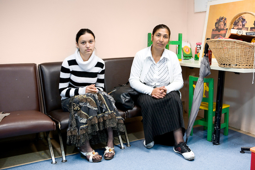 Milan, Italy, May 2008. Centre for immigrant women's health, San Carlo Hospital. Isabela, gipsy, 16 years old, and her mother-in-law, waiting for the gynaecological visit. Isabela is one month pregnant...Milano, Italia, Maggio 2008. Centro di salute e ascolto donne immigrate, Ospedale San Carlo. Isabela, rom, 16 anni, al primo mese di gravidanza aspetta con la suocera il suo turno per la visita ginecologica....