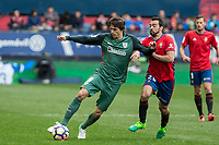 Iturraspe of Athletic Club competes for the ball with De Las Cuevas of Club Atletico Osasuna during the match of  La Liga between Club Atletico Osasuna and Athletic Club Bilbao at El Sadar Stadium  in Pamplona, Spain. April 01, 2017. (ALTERPHOTOS / Rodrigo Jimenez)