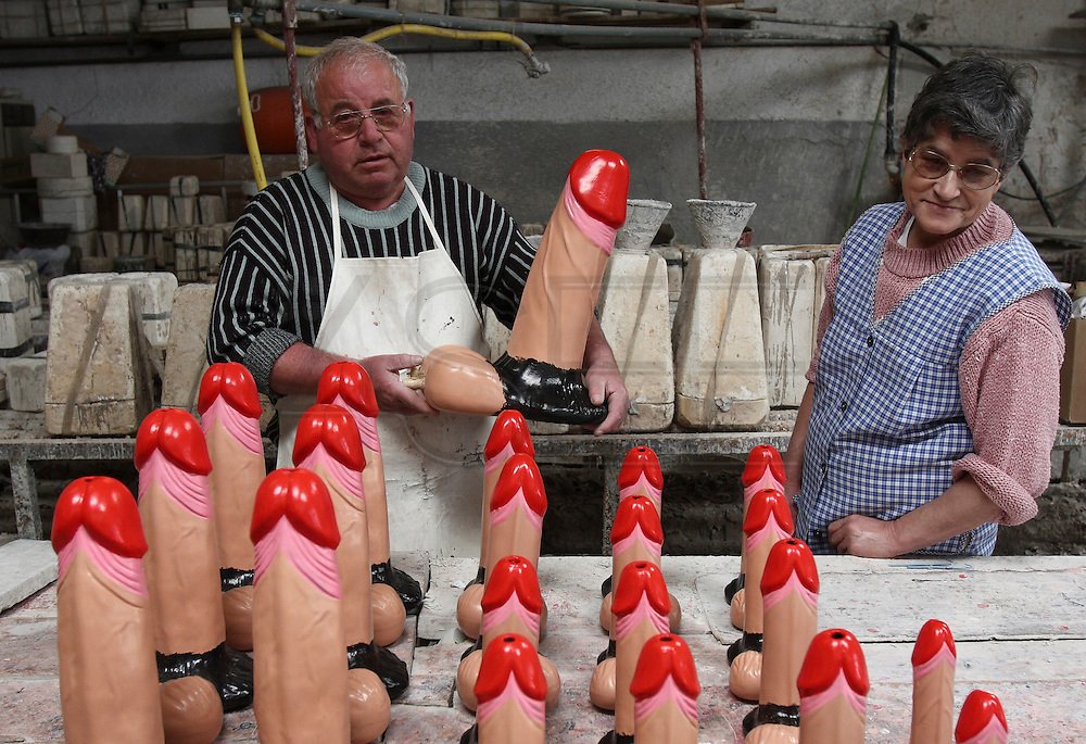 Francisco Silva and his wife showing ceramic phallus created by Francisco in his atelier at Chao da Parada, in Caldas da Rainha city. He is one of the last artisans of this kind of erotic pottery traditional to Caldas da Rainha, in the center region of Portugal  traditional to Caldas da Rainha, in the center region of Portugal.
