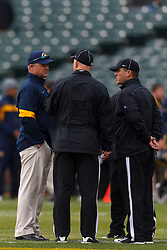 Nov 5, 2011; San Francisco CA, USA;  California Golden Bears head coach Jeff Tedford (left) talks with officials before the game against the Washington State Cougars at AT&T Park.  California defeated Washington State 30-7. Mandatory Credit: Jason O. Watson-US PRESSWIRE