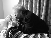 Fabiola Trejo kisses her husband Robert while visiting him at his care facility in Hayward, Calif. Jan. 19, 2009. Robert was diagnosed with Alzheimer's disease in 2002, and Fabiola cared for her husband of over 60 years alone in their home for over four years before he suffered a fall and had to be admitted to the care facility. At the beginning of 2009 it is clear that the end is near, and Fabiola and her daughter visit their husband and father daily as he slips away from them.