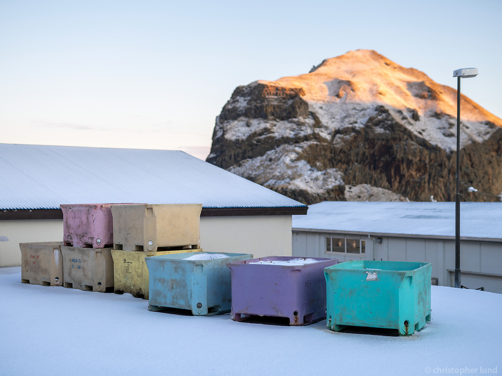 Multi colored plastic containers in Vestmannaeyjar islands, Iceland.