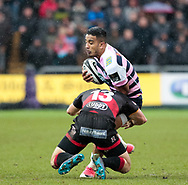 Cardiff Blues' Rey Lee-Lo is tackled by Dragons' Adam Warren<br /> <br /> Photographer Simon King/Replay Images<br /> <br /> Guinness Pro14 Round 11 - Dragons v Cardiff Blues - Tuesday 26th December 2017 - Rodney Parade - Newport<br /> <br /> World Copyright © 2017 Replay Images. All rights reserved. info@replayimages.co.uk - www.replayimages.co.uk