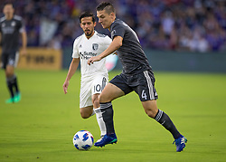 April 21, 2018 - Orlando, FL, U.S. - ORLANDO, FL - APRIL 21: Orlando City midfielder Will Johnson (4) passes the ball during the MLS soccer match between the Orlando City FC and the San Jose Earthquakes at Orlando City SC on April 21, 2018 at Orlando City Stadium in Orlando, FL. (Photo by Andrew Bershaw/Icon Sportswire) (Credit Image: © Andrew Bershaw/Icon SMI via ZUMA Press)