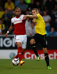 Fulham's Ashkan Dejagah battles with Burton Albion's Chris Hussey-Photo mandatory by-line: Matt Bunn/JMP - Tel: Mobile: 07966 386802 27/08/2013 - SPORT - FOOTBALL - Pirelli Stadium - Burton - Burton Albion V Fulham -  Capital One Cup - Round 2