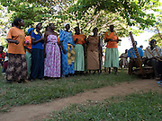 Groups from Send a Cow taking part in a music and drama workshop. These workshops are used to convey and discuss import issues such as gender equality.