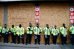 © under license to London News Pictures. 05/02/2011. Police guard boarded buildings. Thousands of English Defence League members and supporters march through Luton Town Centre to demonstrate against Sharia Law. 2000 police are in the town to keep the peace. Photo credit should read: Craig Shepheard / London News Pictures