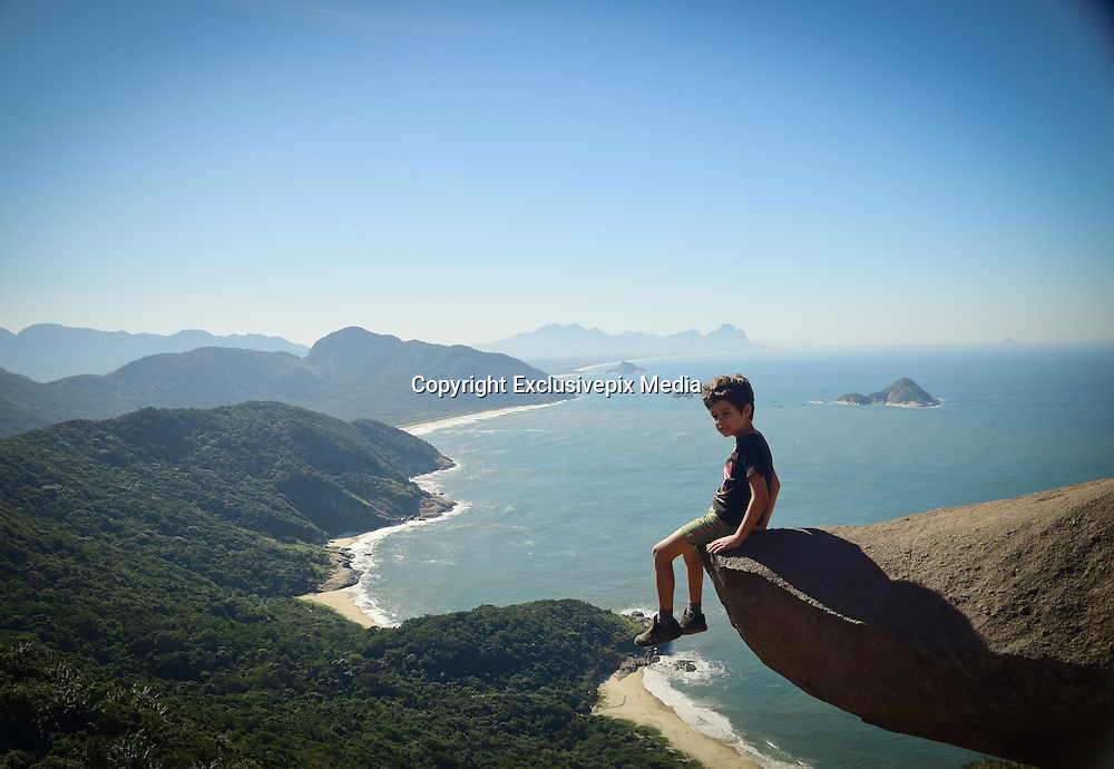 The amazing photo of fitness fanatic, Luis Fernando Candela, in what appeared as him hanging upside down above a 1000 foot drop, has attracted many visitors to the same spot on a beach at Pedra Do Telegrafo in Brazil. The heart-stopping shot was revealed to be a trick of the camera, as there is in fact a plateau directly below the rock where people can stand.<br />  <br /> Photographer, Vivianne Montalvao has captured people striking similar poses on the rock. People have flocked from all over the place to the rock, in hopes their photos also make them look like fearless daredevils<br /> &copy;Exclusivepix Media