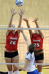24 November 2006: Kari Staehlin (26) and Peggy Riessen stretch for a ball hit by Lauren Bloemke during a Quarterfinal match between the Illinois State University Redbirds and the Creighton University Bluejays. The Tournament was held at Redbird Arena on the campus of Illinois State University in Normal Illinois.<br />