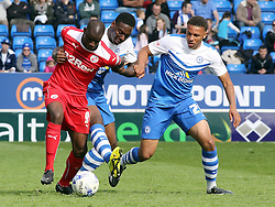 Peterborough United's Ricardo Santos and Jonathan Edwards in action with Crawley's Izale McLeod- Photo mandatory by-line: Joe Dent/JMP - Mobile: 07966 386802 - 25/04/2015 - SPORT - Football - Peterborough - ABAX Stadium - Peterborough United v Crawley Town - Sky Bet League One
