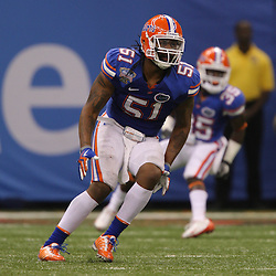 Jan 01, 2010; New Orleans, LA, USA;  Florida Gators linebacker Brandon Spikes (51) pursues a play during the 2010 Sugar Bowl at the Louisiana Superdome. Florida defeated Cincinnati 51-24.  Mandatory Credit: Derick E. Hingle-US PRESSWIRE.